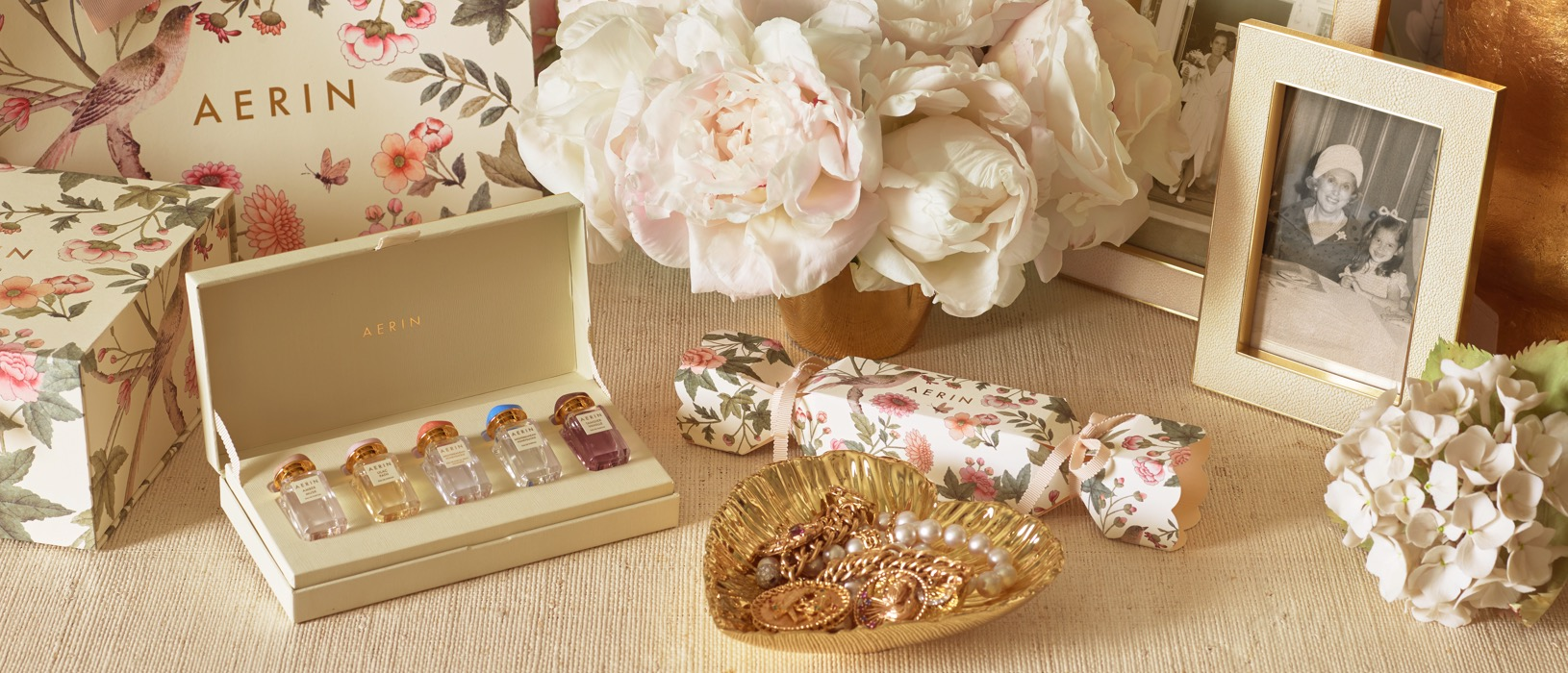 The AERIN Holiday Fragrance Coffret Set, gold heart dish and Cream Shagreen Frame