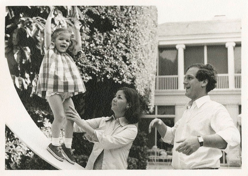 Aerin as a young girl with her mother and father