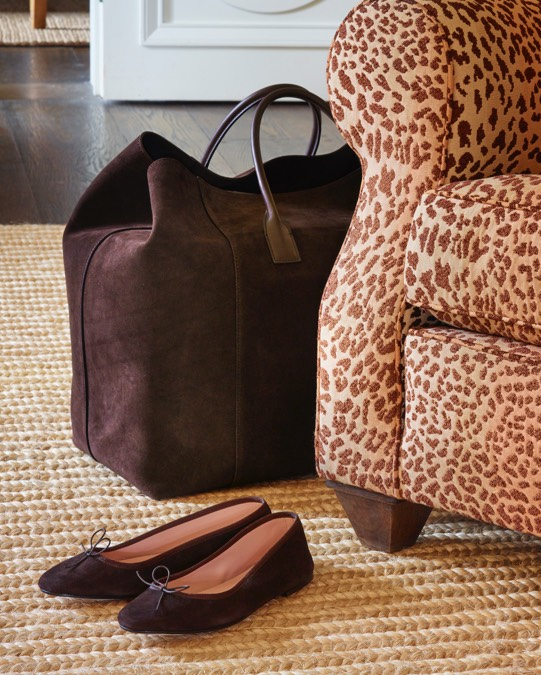 The new oversized weekender and suede ballet flats in cocoa beautifully offset a leopard chair.