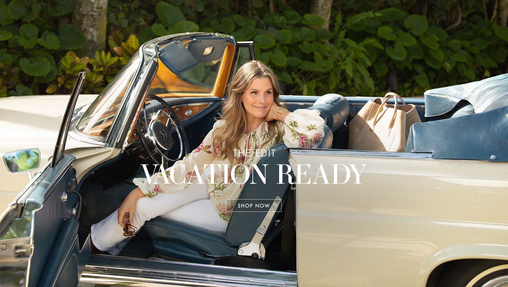 Aerin in a vintage car ready for a warm-weather spring getaway.