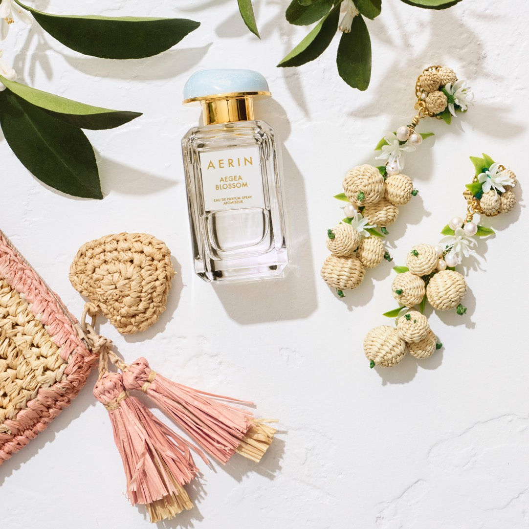 AERIN raffia pouch, Aegea Blossom Eu de Parfum and AERIN x Mercedes Salazer earrings