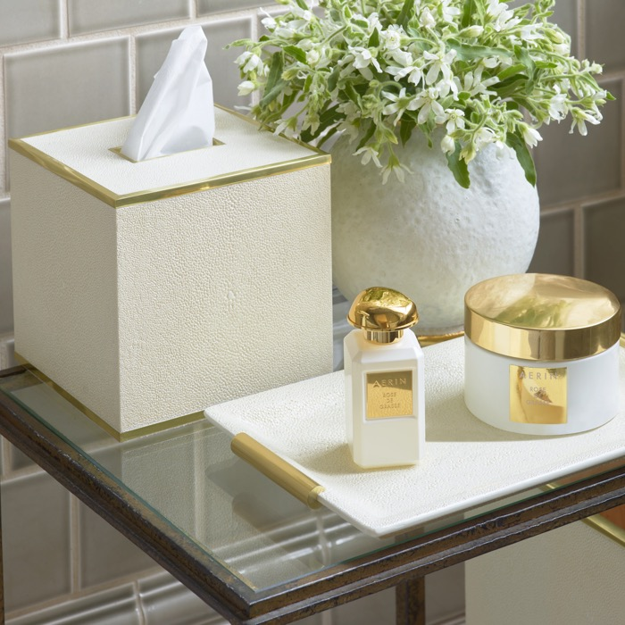 A Cream Shagreen Vanity Tray holding a Rose de Grasse fragrance, body cream and rollerball, sits next to a cream shagreen tissue box and Marion Round Vase