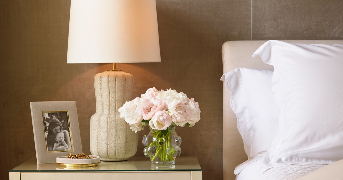 Soft neutrals, such as the Aumar Large Table Lamp and the Velvet Valentina Frame set the tone for a relaxing bedroom