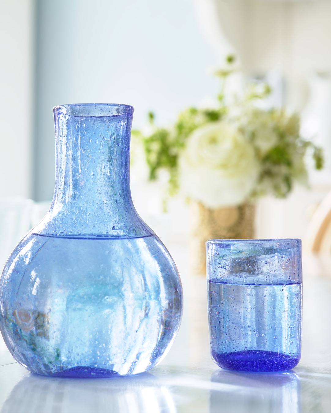 The Ines Carafe and Glass Set beautifully completes a summer table.