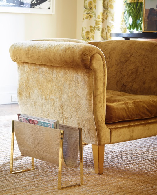 The Croc Magazine Rack adds a beautiful touch to Aerin's living room