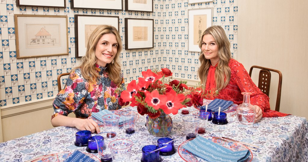 Aerin Lauder and Martina Mondadori Sartogo by a table full of AERIN x Cabana merchandise