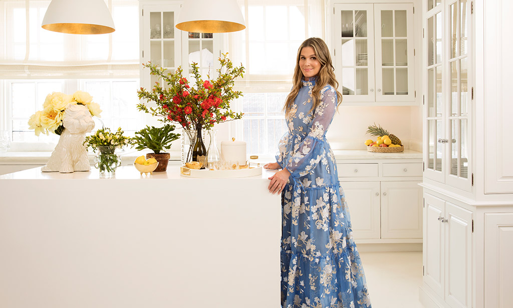 Aerin in her kitchen preparing to entertain with her favorite AERIN Home Décor essentials
