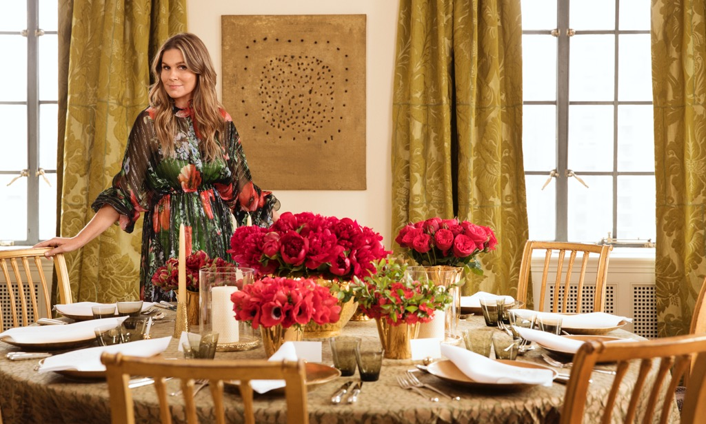 Aerin putting the finishing touches on a holiday tablescape