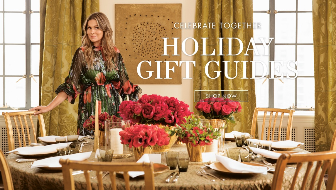 Aerin standing behind a table set for a holiday dinner party