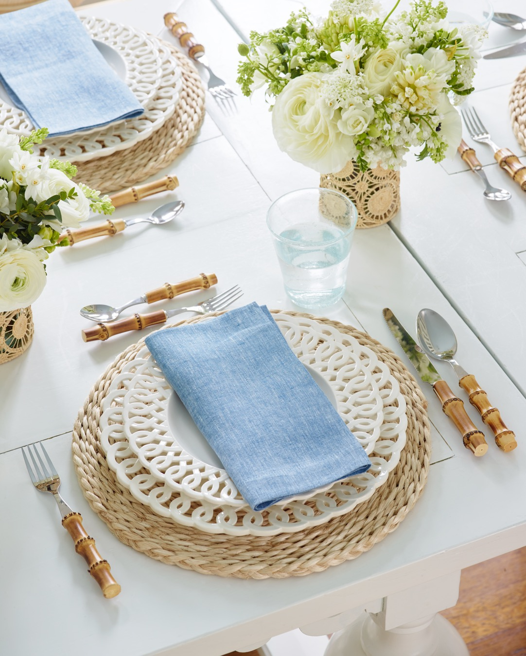 Beautiful plates, bamboo flatware and linens to set a summer table