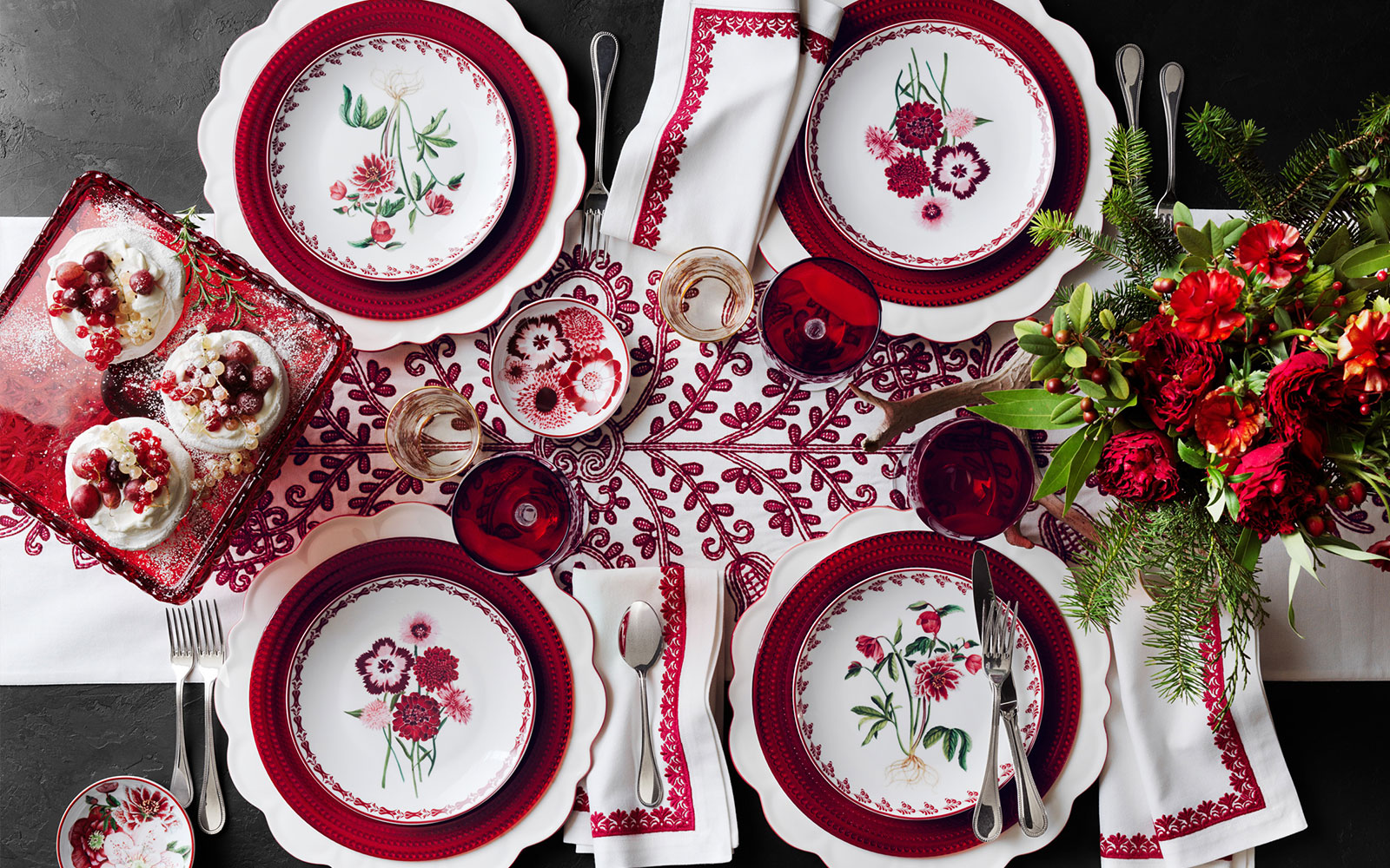 A tablescape showcasing the new plates, glasses and linens from the AERIN Collection by Williams Sonoma
