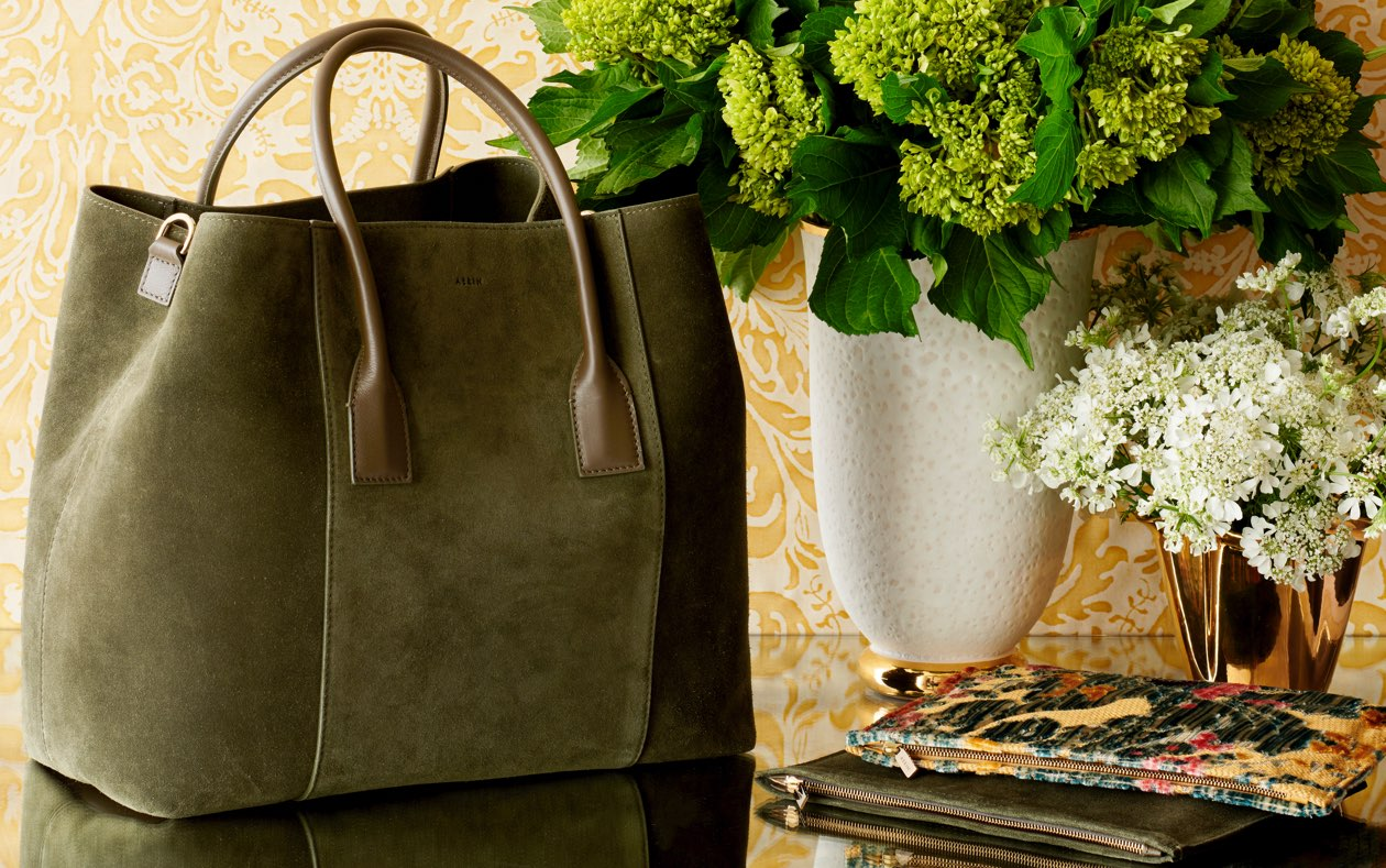 The AERIN Mini Weekender in the new color, Loden and pouches