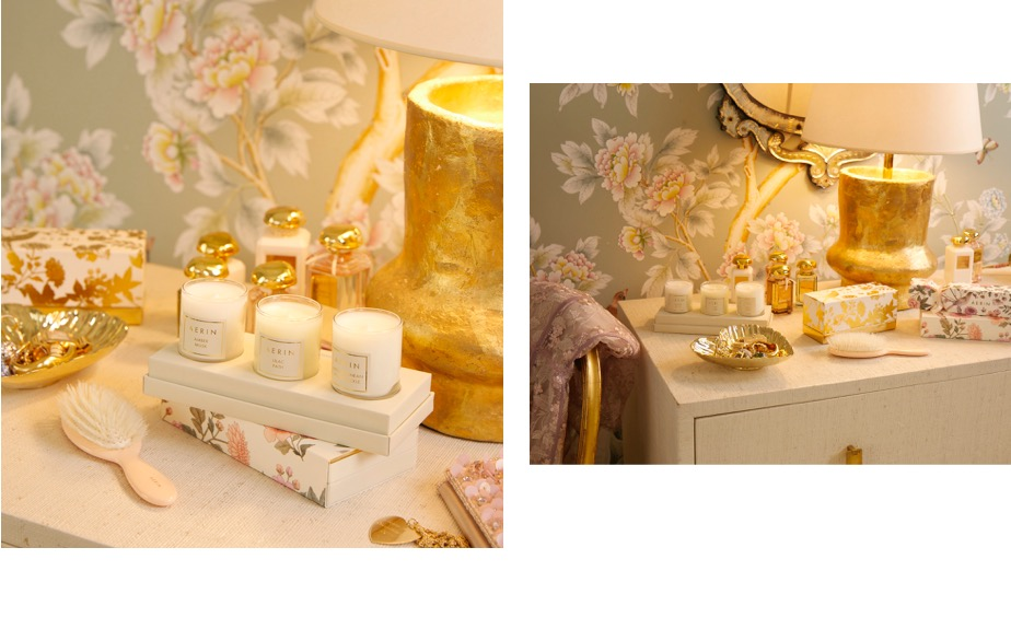The top of Aerin's dresser with a set of mini candles and a pink hairbrush