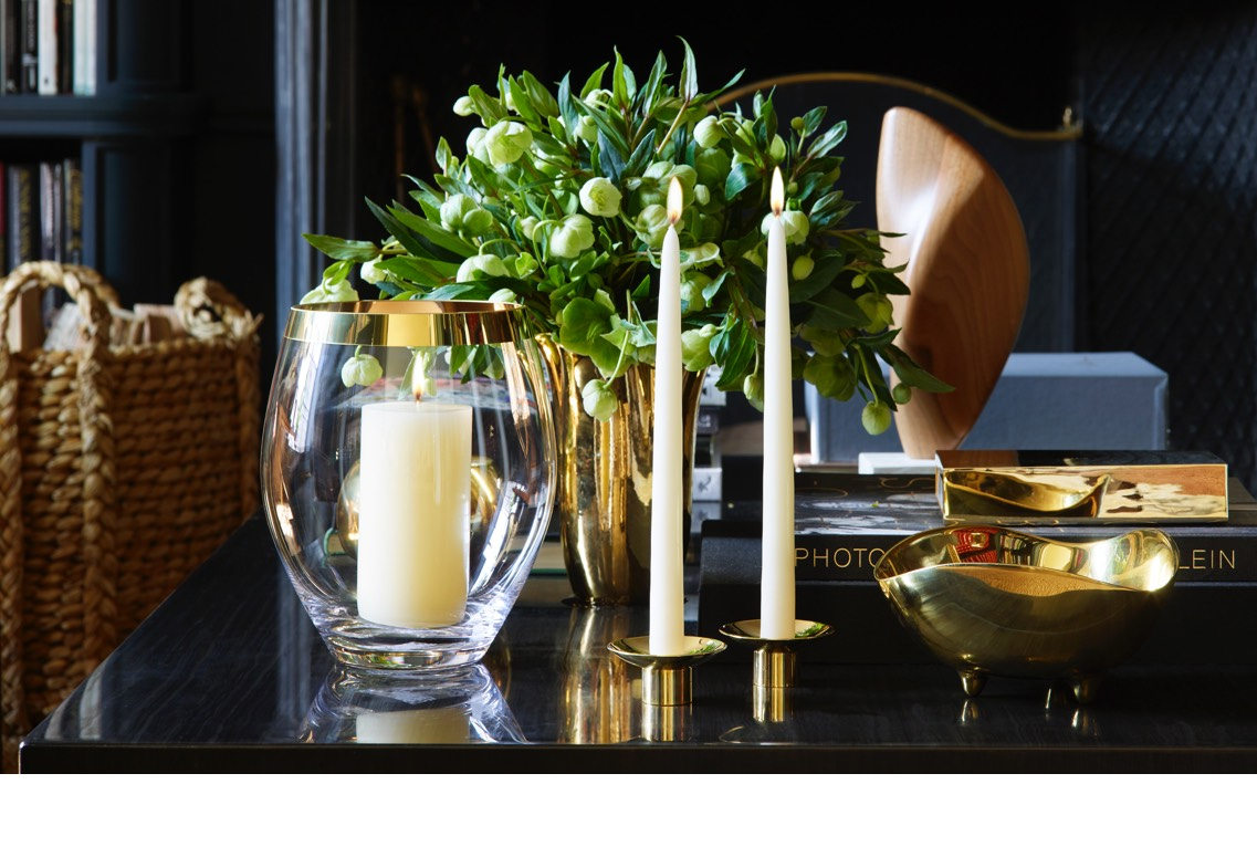 The new Gabriel Hurricane and Evelina candle holders on Aerin's coffee table