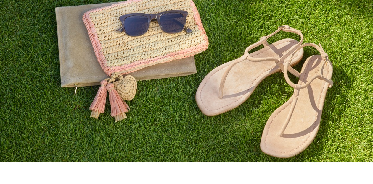 Sandals and pouches make the perfect getaway accessories