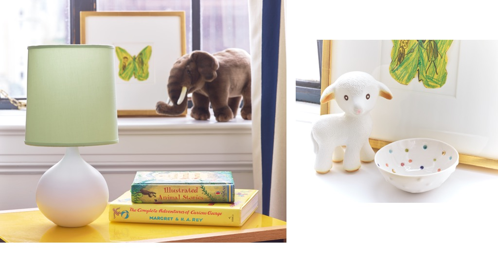 The AERIN Mini Warren Table Lamp with the Pale Green Mini Warren Lamp Shade on a kids table and the AERIN Pixel Bowl in front of a child's artwork