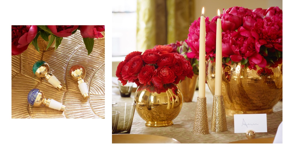 Three Jade Stone Bottle Stoppers, tulln candle holders, a gold marion vase and gold cachepot atop a table