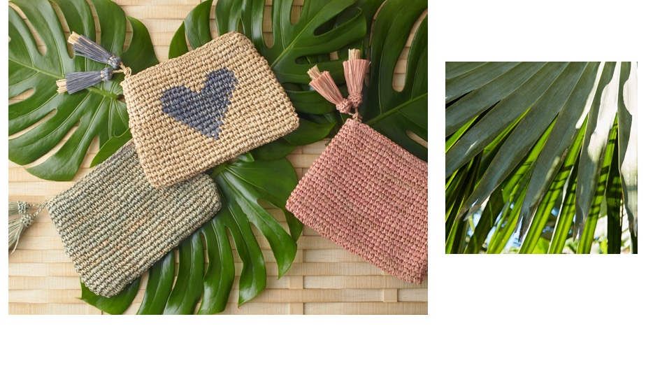 Raffia pouches resting on palm leaves