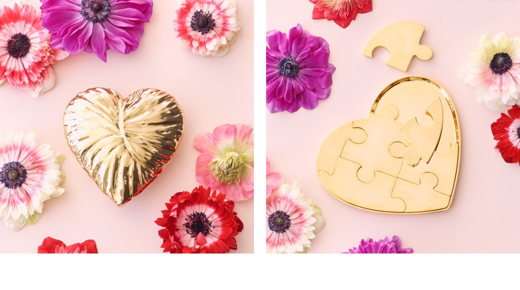 The AERIN AMBROISE HEART OBJECT and the AERIN Heart Puzzle Object on pink backgrounds with flowers